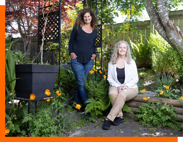 glorie averbach, betty hasker myceo business coaches seated in a garden